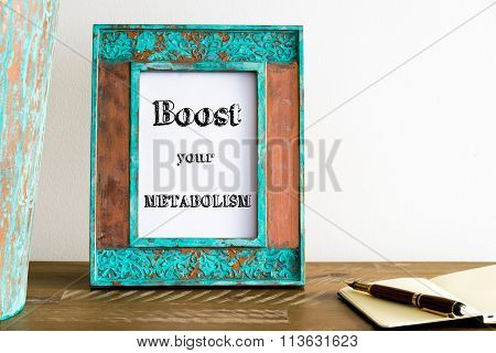Vintage Photo Frame On Wooden Table With Text Boost Your Metabolism