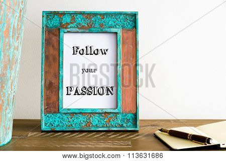 Vintage Photo Frame On Wooden Table With Text Follow Your Passion