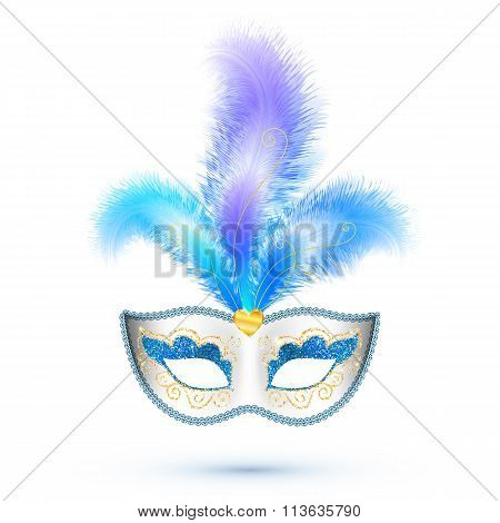 White carnival mask with blue feathers and golden glitter isolated on white background