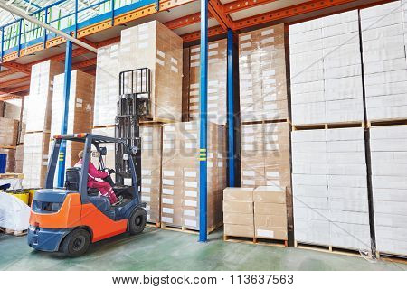 forklift loader working in warehouse