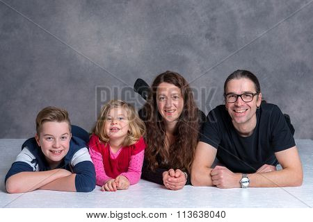Nice Family Lying On The Flor