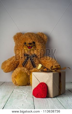 Teddy bear, red heart and gift box