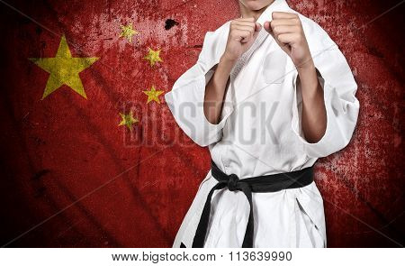 Karate Fighter In Kimono And China Flag