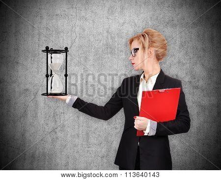 Businesswoman Holding Sandglass