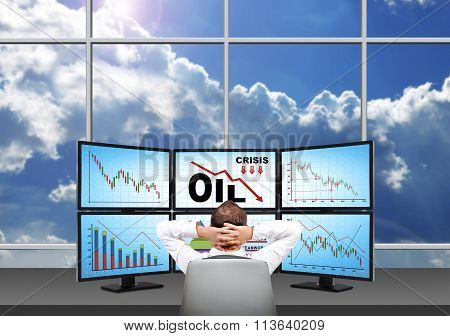 Trader Looking On Statistics Fall In Oil Prices