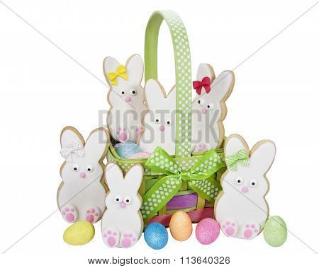 Easter Bunny family of cookies in basket decorated with marshmallow fondant