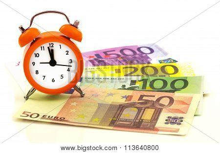 Alarm Clock With Paper Euro Money 50, 100, 200, 500