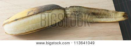 Open Ripen Banana Fruit On Wooden Table