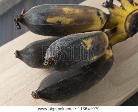 Ripen Banana Fruit On A Wooden Board