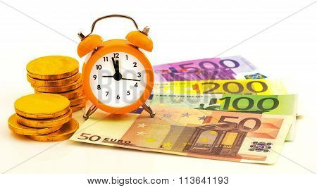 Alarm Clock With Paper Euro Money And Gold Coins