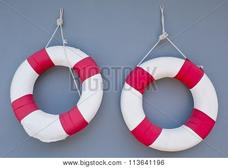 Two Life Buoy Hanging On A Wall