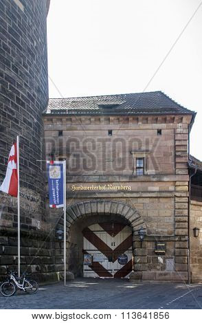 NUREMBERG, GERMANY - AUGUST 23, 2015: The Frauentor is the main gate in the southeast of the Nuremberg city walls and the remarkable Women's Tower (Frauentorturm) is one of four towers of the city walls