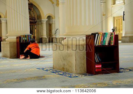 A boy reading Quran in Sultan Abu Bakar State Mosque in Johor Bharu, Malaysia