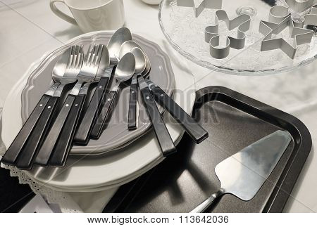 Porcelain Plates, Coffee Cup, Silverware And Cookie Cutters