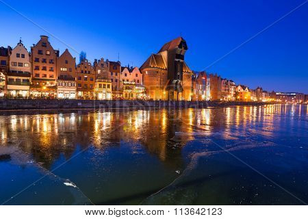 The old town of Gdansk at frozen Motlawa river, Poland