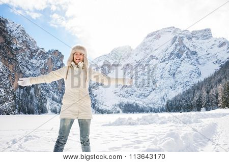 Happy Young Woman Standing In Winter Outdoors And Rejoicing