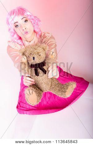Childlike Woman With Teddy Bear Toy