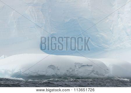Cavern In Blue Glacial Iceberg, Antarctica