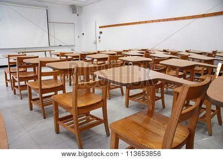 armed chairs in the classroom in university