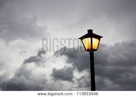 street lamp against storm sky