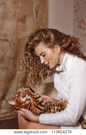 Girl Scratching Cat.