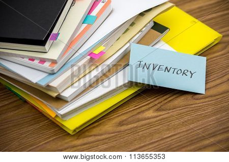 Inventory; The Pile Of Business Documents On The Desk