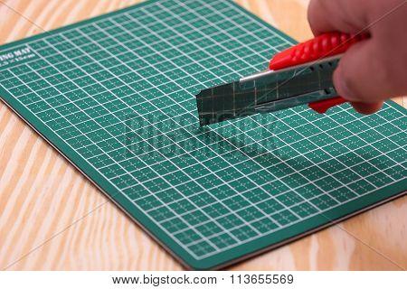 Cutter On Green Cutting Mat
