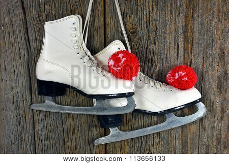 ice skates with yarn pompoms