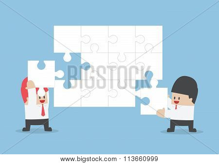 Businessman Help Each Other To Assemble Blank Jigsaw
