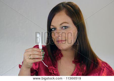 Young Woman Holds A Tampon