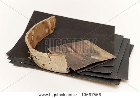 A Set Of Sandpaper And Bark