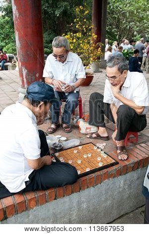 Asion senior people playing chess