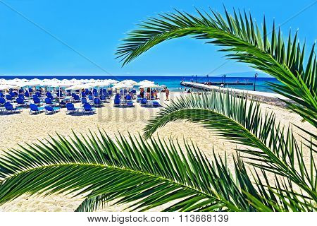 View Of The Beach With A Rest People, Sun Loungers And Parasols