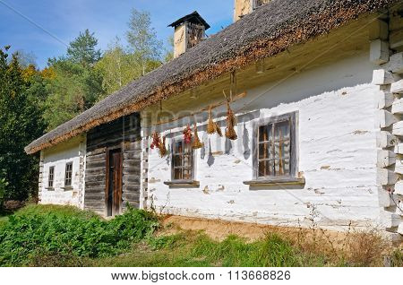 Old Farmhouse With A Thatched Roof