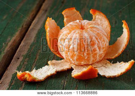 Peeled Mandarin On Green Board