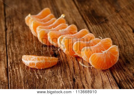 Pieces Of Mandarin Fruit On Wooden Board