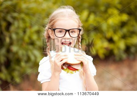 Girl biting sandwich