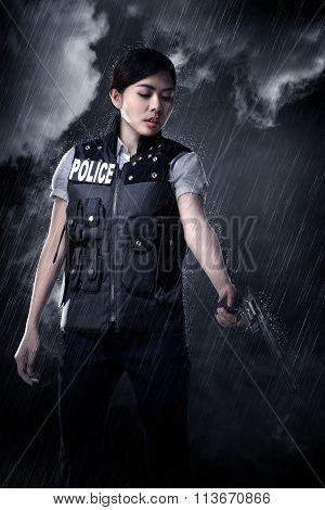 Beautiful Police Woman Holding Gun