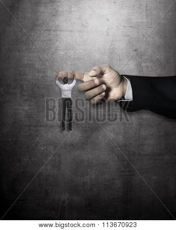 Asian Business Man Hang On Large Finger