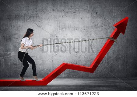 Business Woman Pulling Arrow With Chain