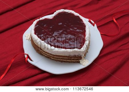 Heart Shaped Cake With Red Marmalade Served On Vintage Dish On Red Drapery