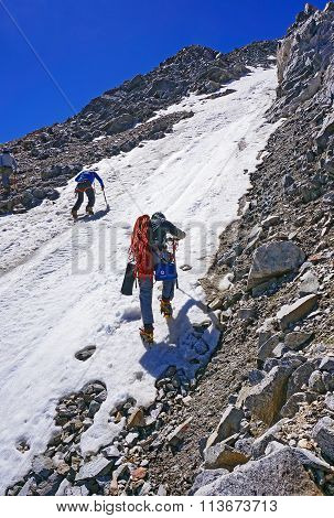 Group Of Mountaineers Make The Ascent Of The Mountain On Snow-covered Hillside Plot