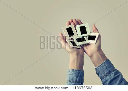 Female Hand Holding A Old Photo Slides Frame. Vintage Look