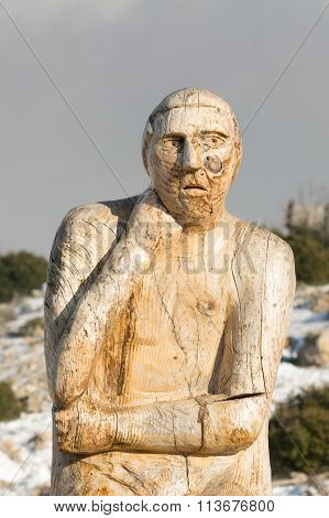 Athens, Greece 02 January 2016. Thinking man wood carving at the park of lost souls (Parko Psychon)