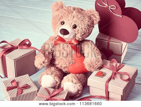 Valentines Day. Teddy Bear Love.Gift boxes on wood