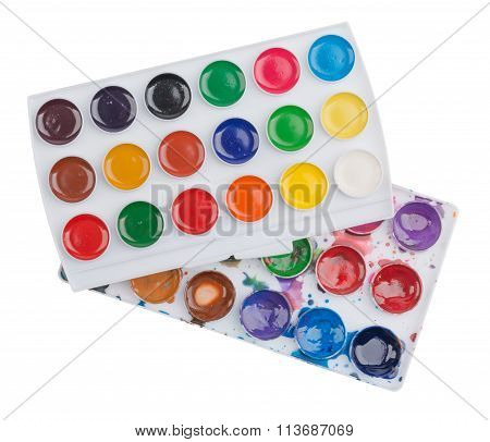 Watercolor paints in palette isolated on white background