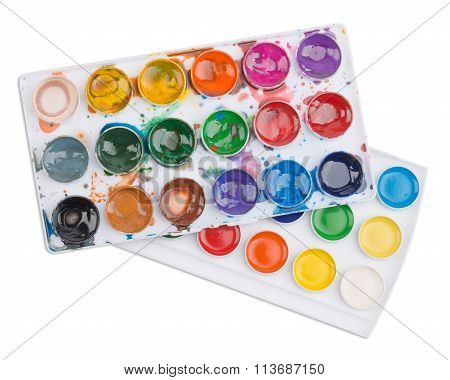 New and used watercolor paints in palette isolated on white background