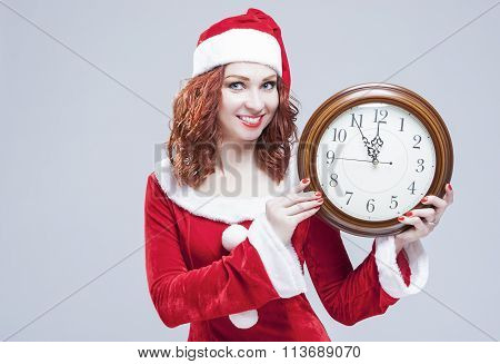 Time And Christmas Holiday Concept. Portrait Of Smiling And Gleeful Red-haired Santa Helper Showing
