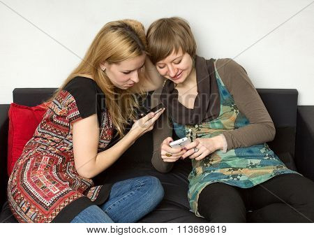 Two Yong Women With Cellphones