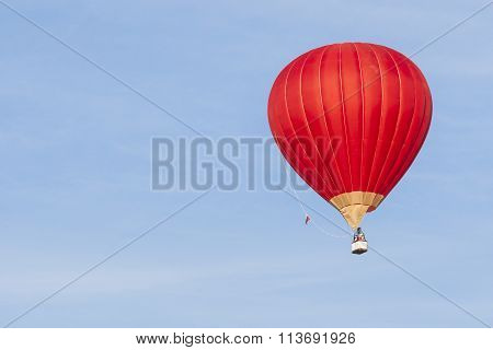 Air Balloon Levitating Over The Crowd Of People Standing Outdoors And Watching
